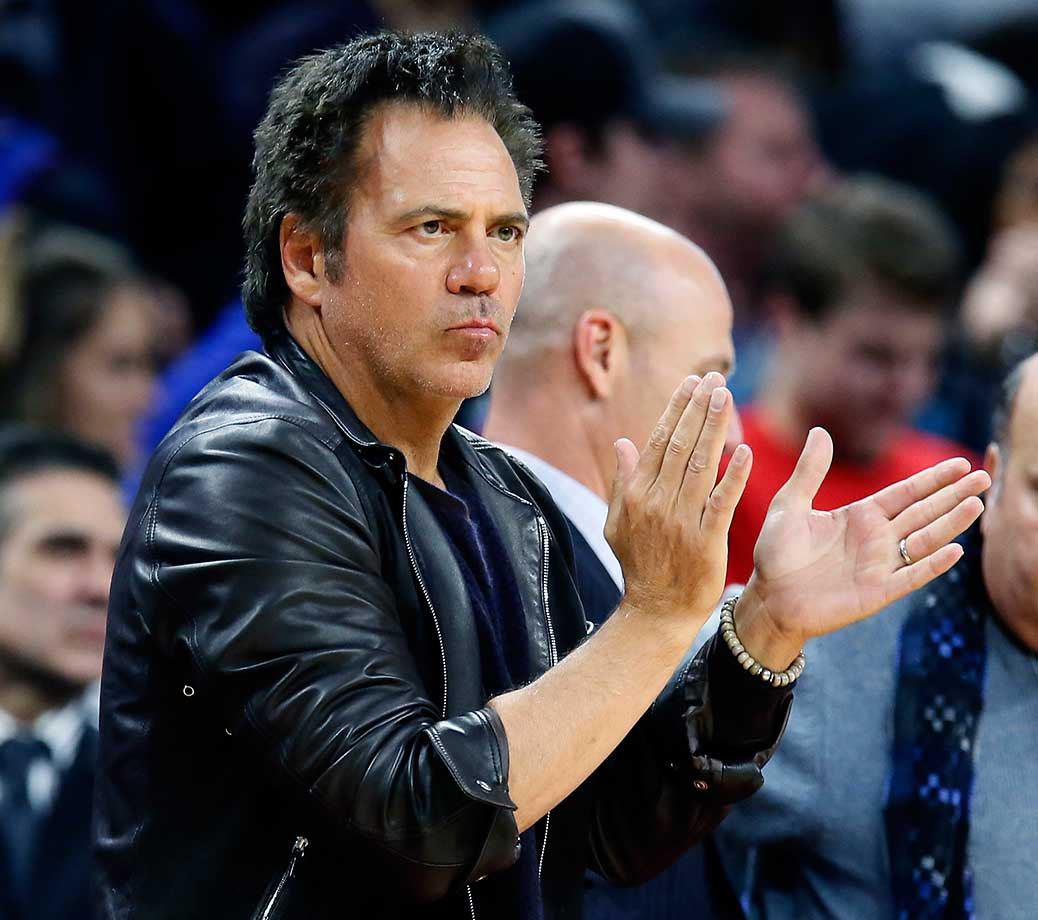 Detroit Pistons owner Tom Gores applauds his team during a 118-102 win over the Orlando Magic.