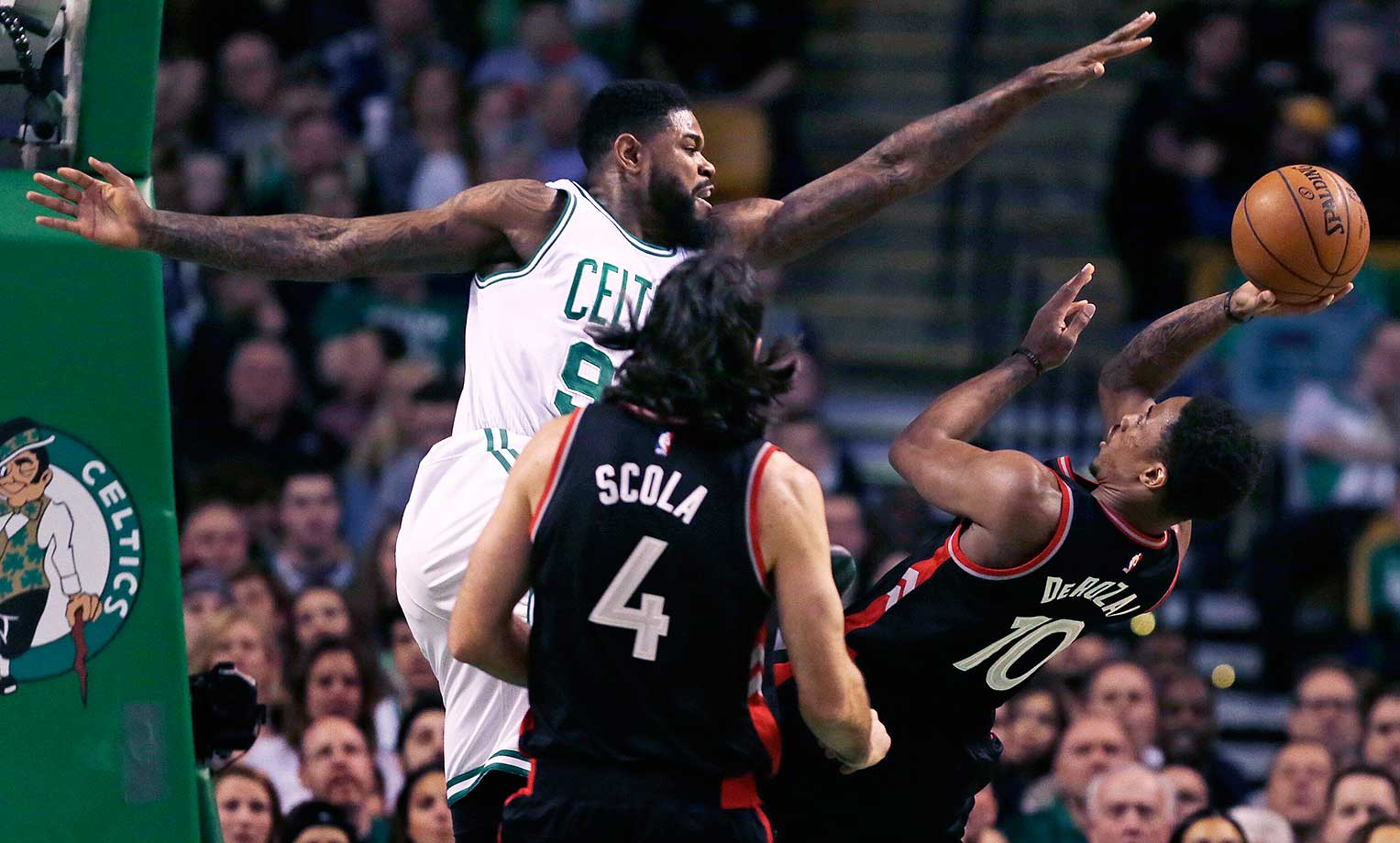 Boston Celtics forward Amir Johnson tries to block Toronto Raptors guard DeMar DeRozan.