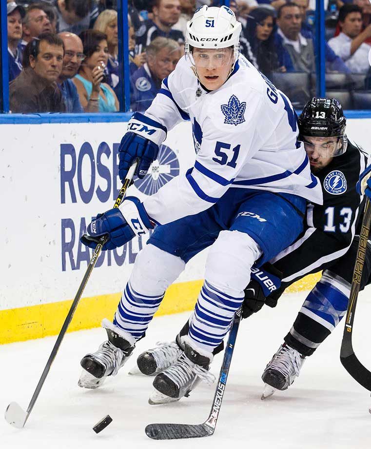Cedric Paquette of the Tampa Bay Lightning rear ends Jake Gardiner of the Toronto Maple Leafs.