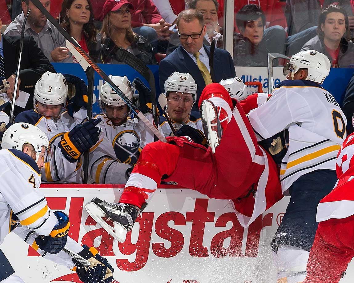 Evander Kane of Buffalo checks Justin Abdelkader of Detroit into the Sabres bench.