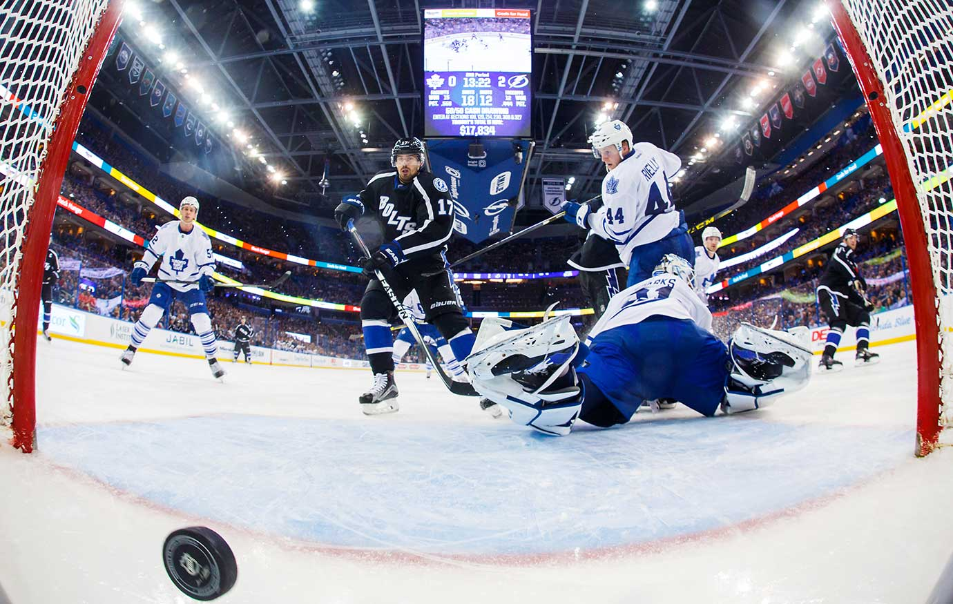 Alex Killorn of Tampa Bay watches the puck goes in on a shot from teammate Victor Hedman (77) against goalie Garret Sparks of  Toronto.