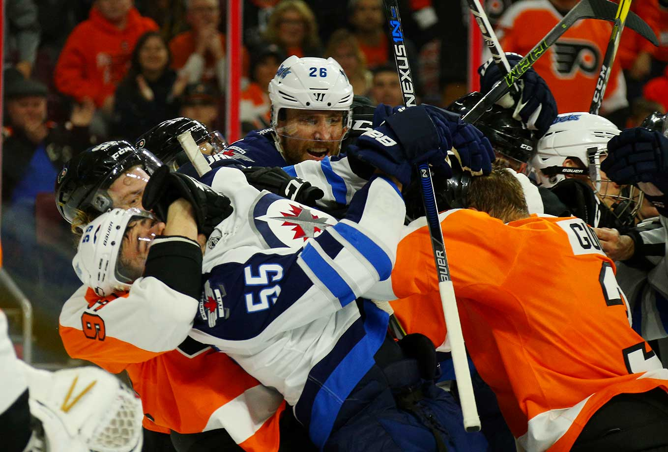 Jakub Voracek (93) and Radko Gudas (3) of Philadelphia combine on Mark Scheifele (55) of Winnipeg.