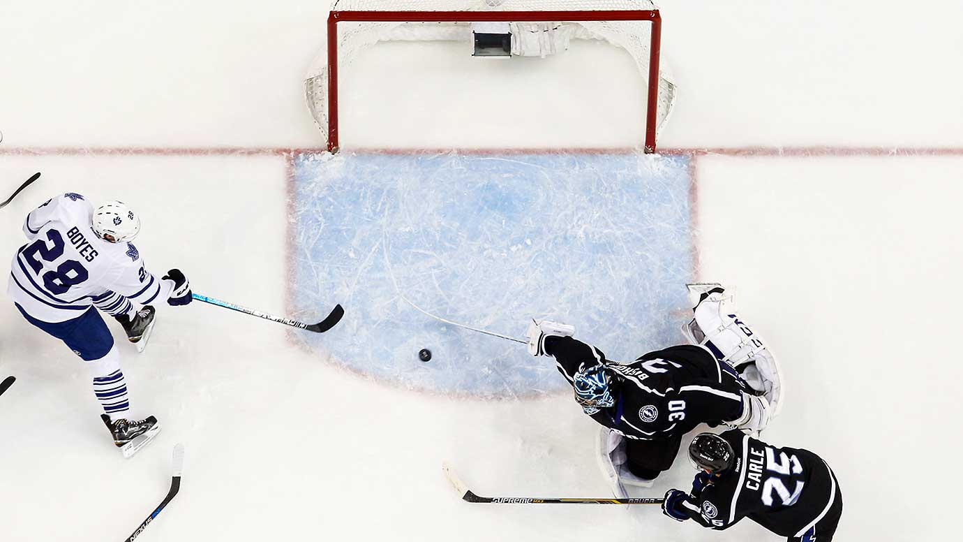 Goalie Ben Bishop of Tampa Bay stretches to make a save against Brad Boyes of Toronto.