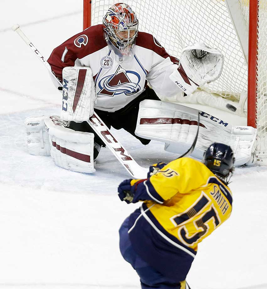 Nashville Predators center Craig Smith scores against Colorado Avalanche goalie Semyon Varlamov.