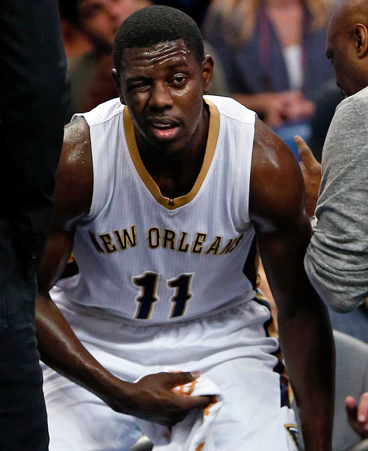 New Orleans Pelicans guard Jrue Holiday leaves the game after being injured. He'll have his orbital bone examined before Wednesday's game.