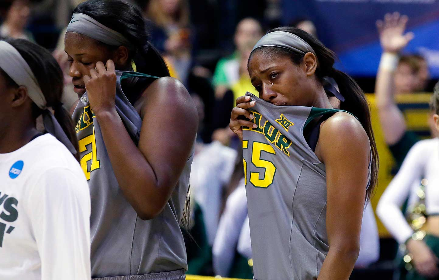 Baylor forwards Kalani Brown (21) and Khadijiah Cave (55) wipe their eyes at the end of a 60-57 regional final loss to Oregon State.