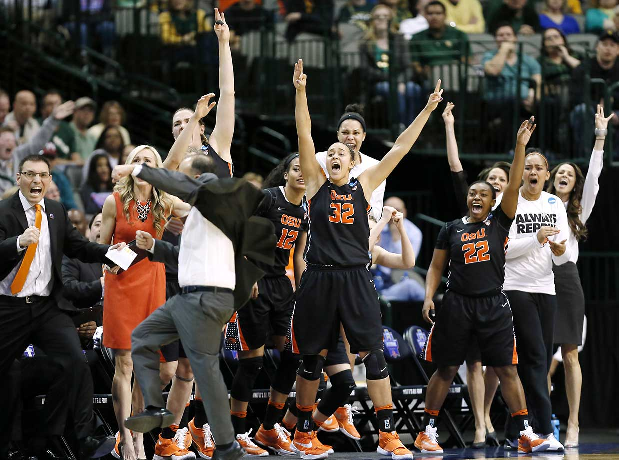 The Oregon State bench erupts on a buzzer beater shot to end the first half of a regional final against Baylor. The team went on to win and will face UConn in the Final Four.