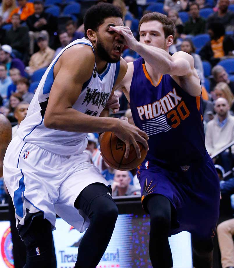 Phoenix forward Jon Leuer hits Minnesota center Karl-Anthony Towns in the eyes as Towns drives to the basket.