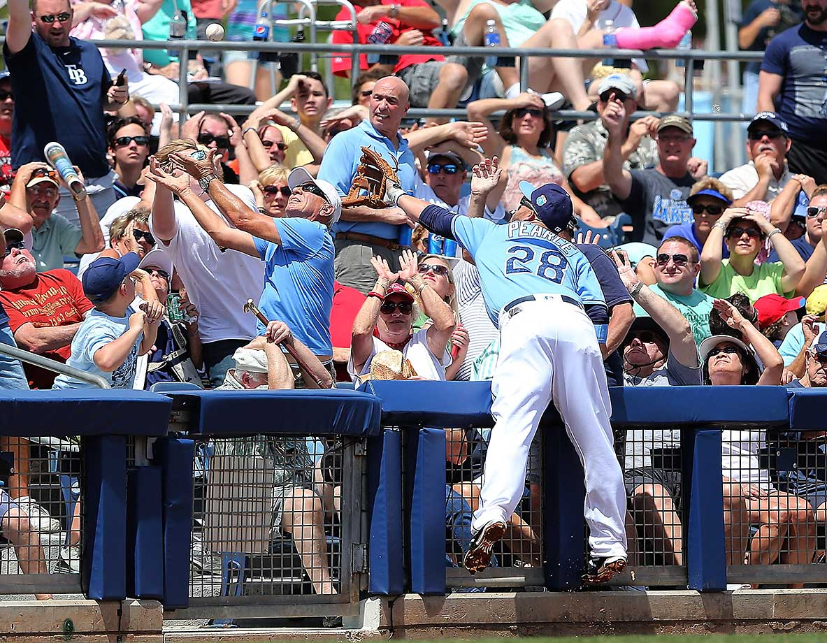 Steve Pearce of the Tampa Bay Rays reaches for a foul ball in Port Charlotte, Fla.