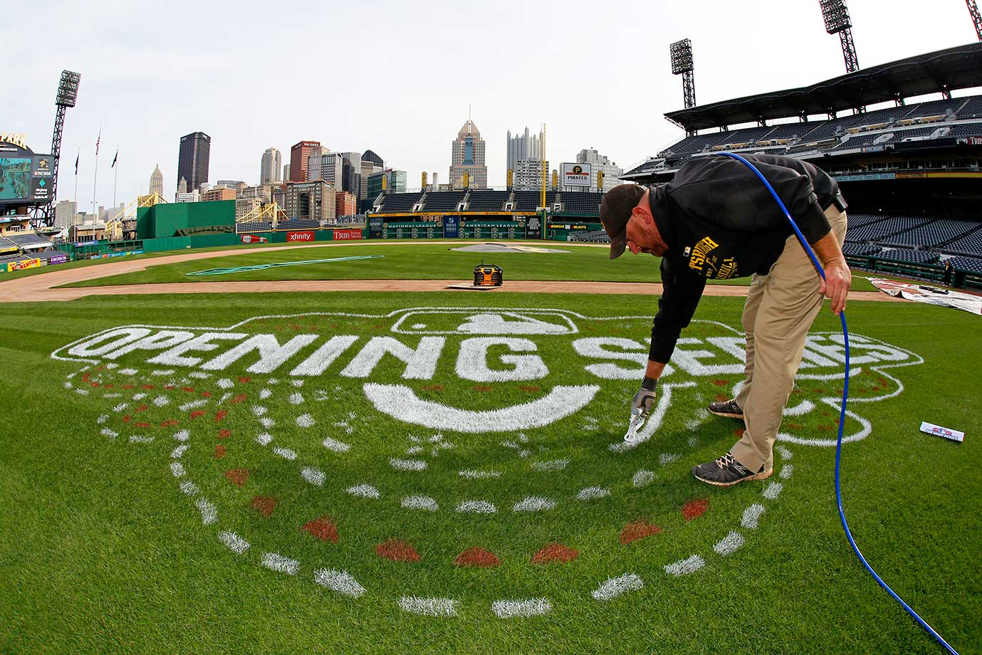 Matt Gerhardt paints the field in Pittsburgh in advance of Sunday's MLB season opener between the Pirates and St. Louis Cardinals.