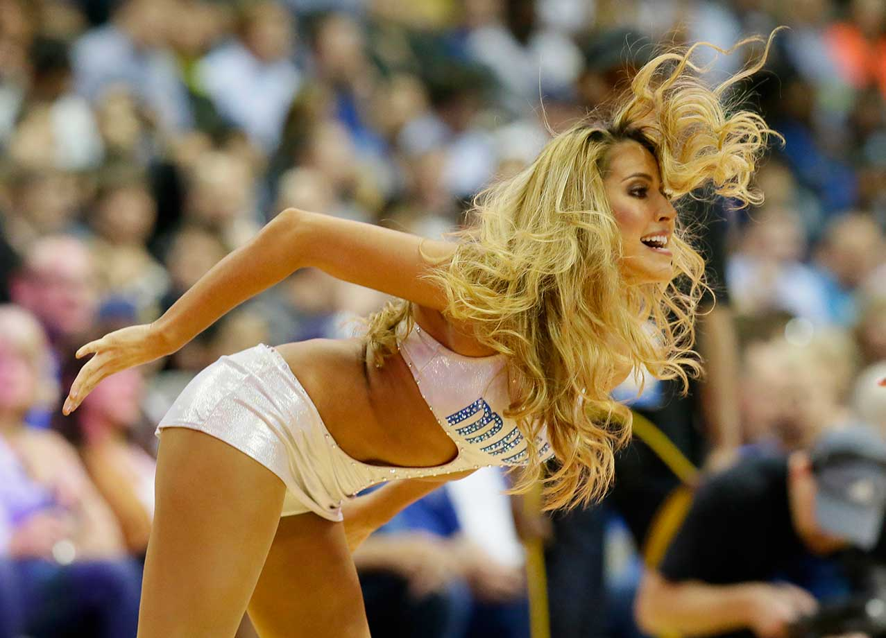 A Dallas Mavericks dancer performs during a break in the action at Wednesday's game.