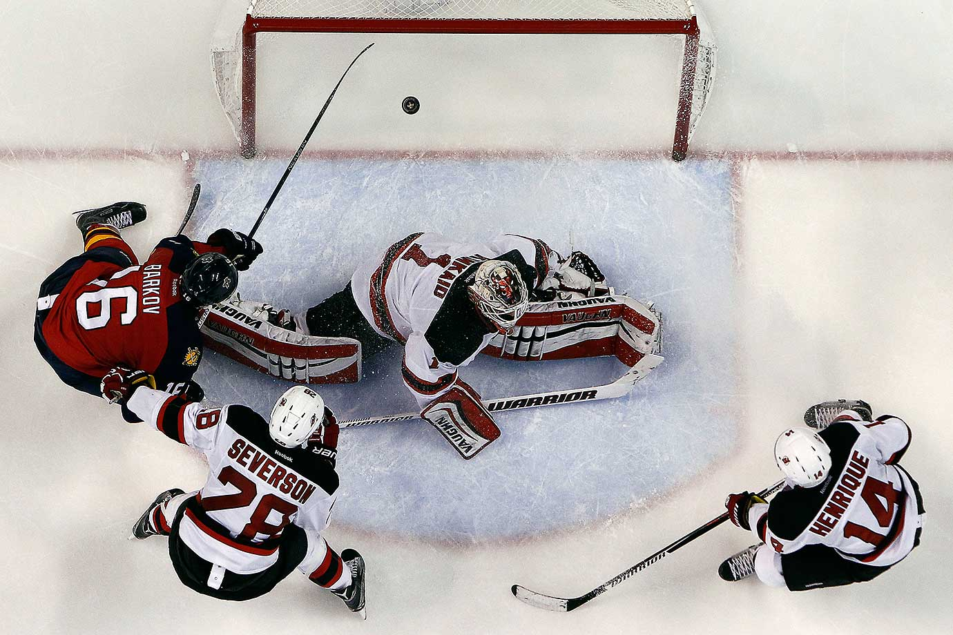 Aleksander Barkov of the Florida Panthers scores against Goaltender Keith Kinkaid of the New Jersey Devils.