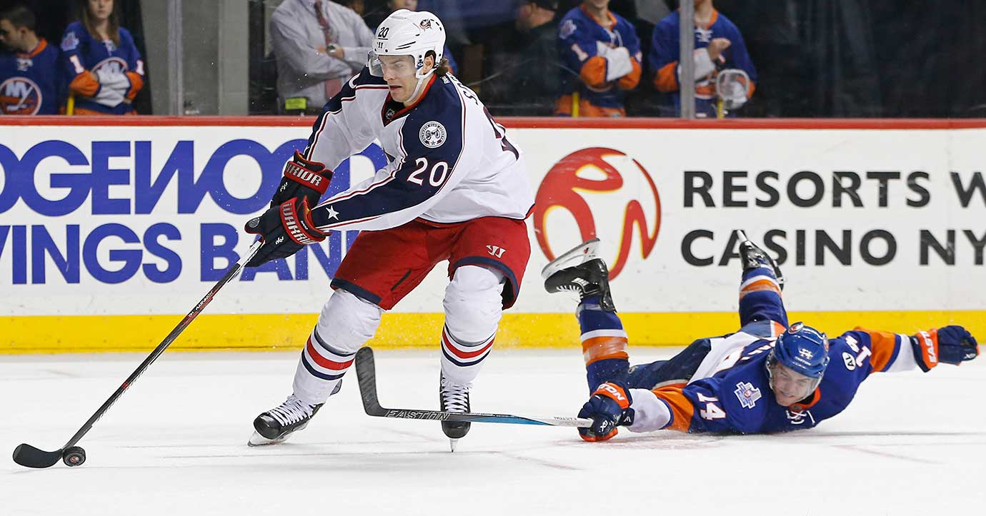 New York Islanders defenseman Thomas Hickey falls while trying to block a shot by Brandon Saad of Columbus.