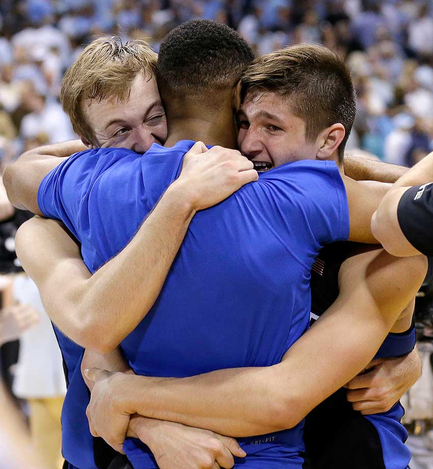 Duke's Luke Kennard, left, and Grayson Allen, right, hug an injured Matt Jones after Duke's 74-73 win at No. 5 North Carolina.