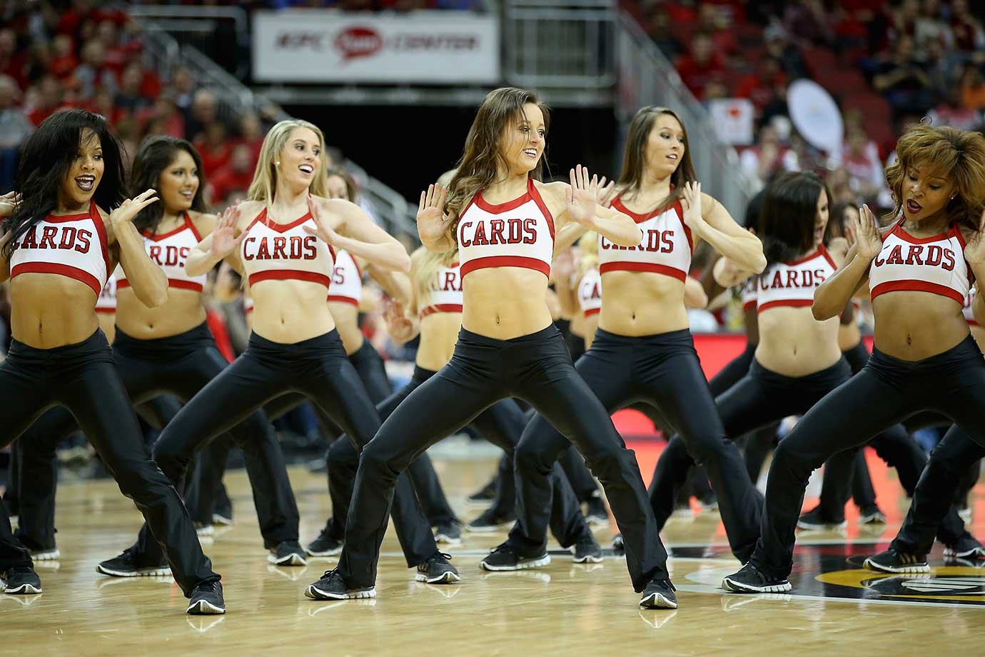 The Louisville Cardinals cheerleaders perform during their team's game against the Syracuse Orange.