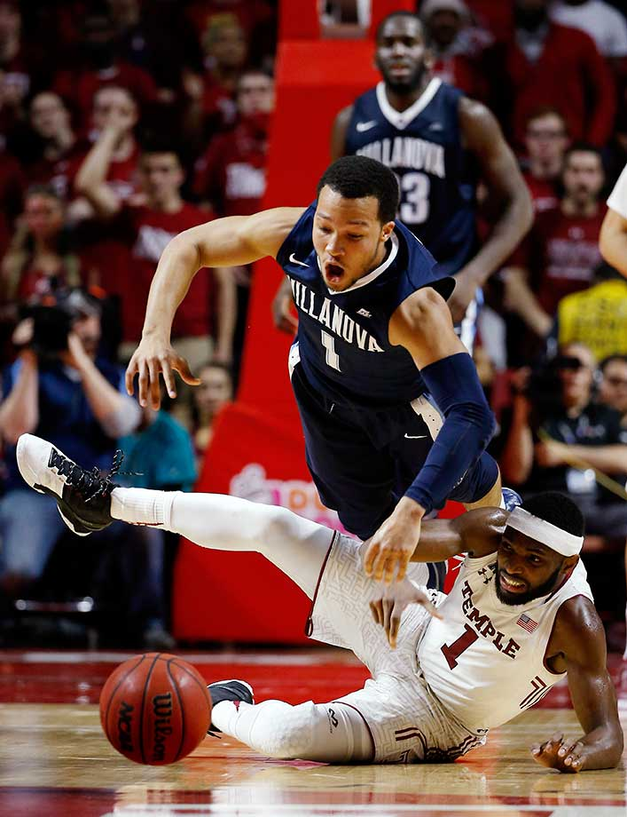Villanova's Jalen Brunson and Temple's Josh Brown collide while chasing the ball.