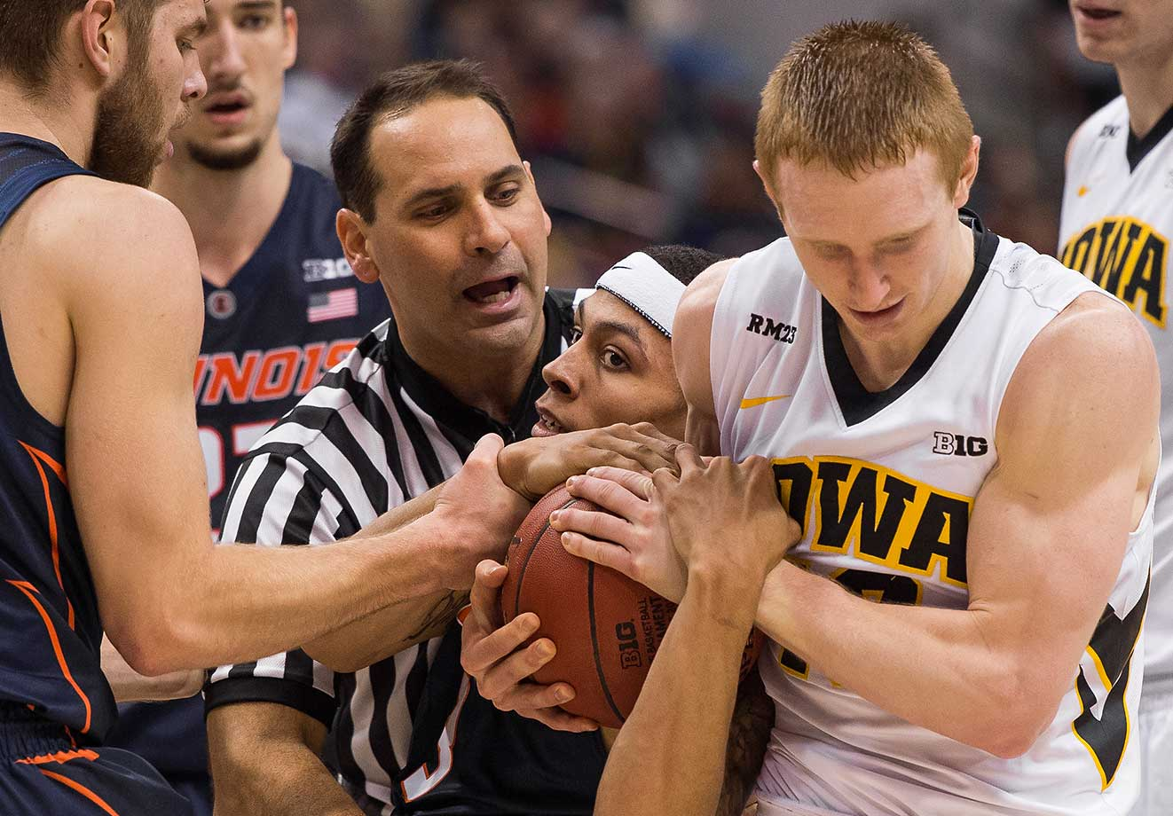 Iowa guard Mike Gesell battles for a held ball during a Big Ten Tournament game against Illinois.