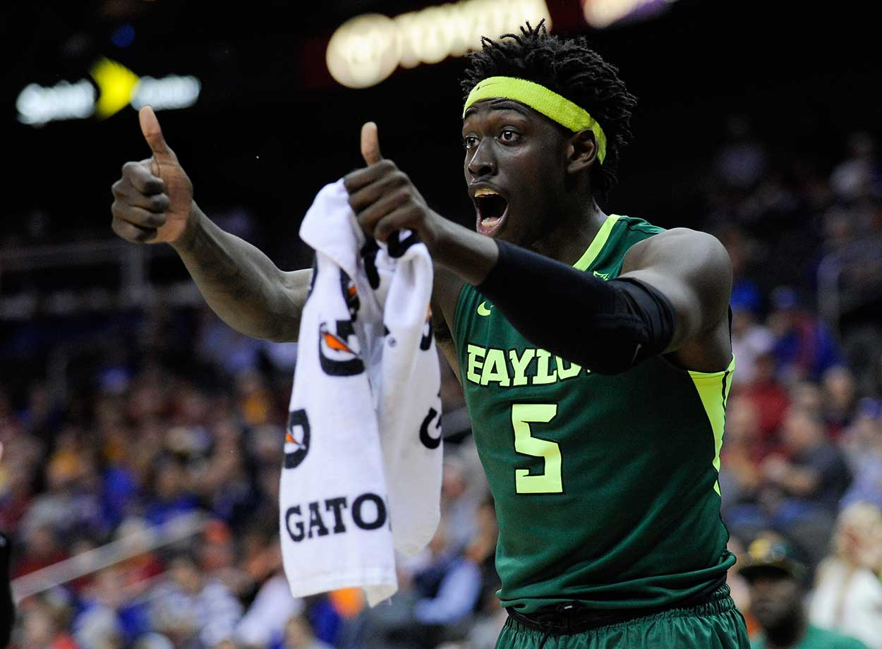 Johnathan Motley of Baylor cheers on his team during a game against the Texas Longhorns.
