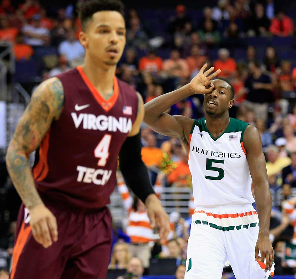 Davon Reed of the Miami Hurricanes celebrates in front of Seth Allen of Virginia Tech.