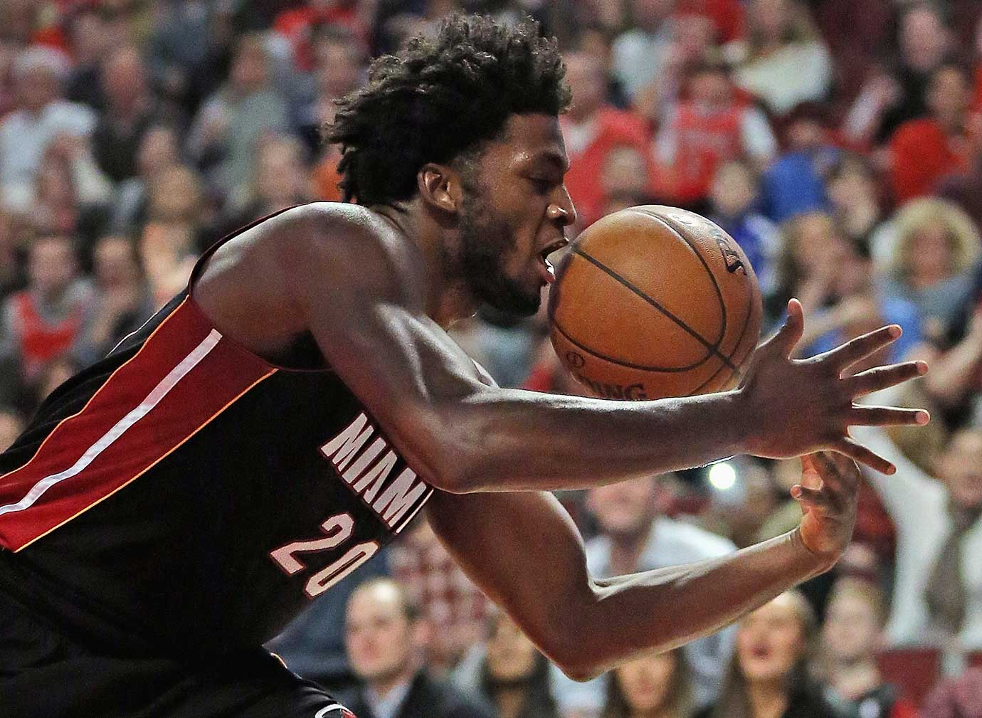 Justise Winslow of the Miami Heat grabs a rebound against the Chicago Bulls.