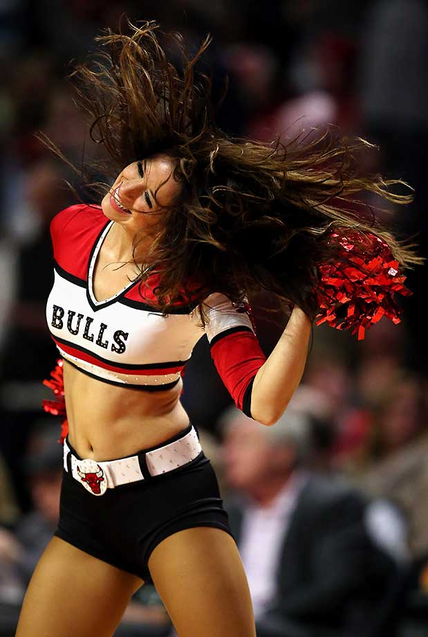 A member of the Chicago Bulls dance team performs during a break between the Bulls and the Miami Heat.