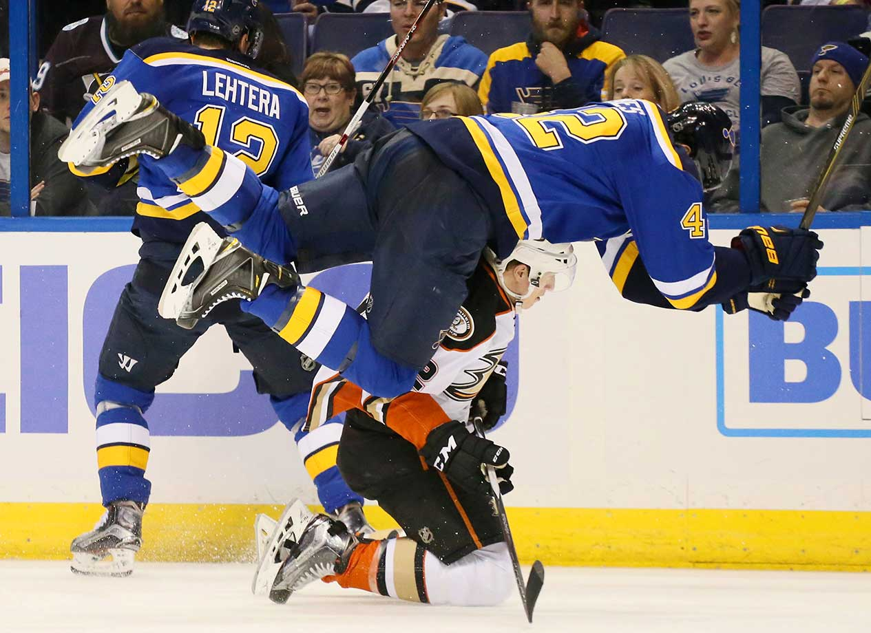 David Backes of the St. Louis Blues tumbles over Josh Manson of the Anaheim Ducks.