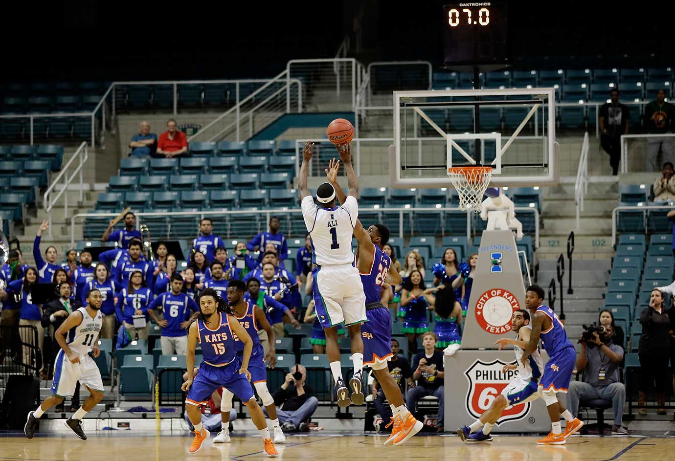 Texas A&M Corpus Christi's Hameed Ali makes a three-pointer in the finals seconds of a 79-76 win over Sam Houston State.