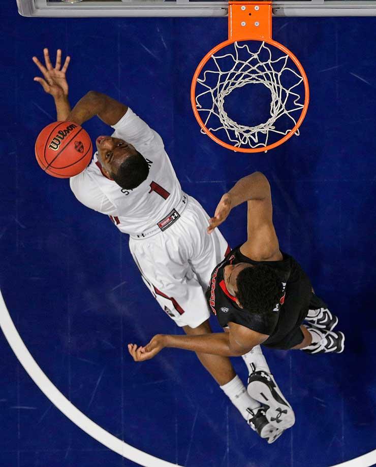 South Carolina's Marcus Stroman falls to the court as a Georgia player defends.