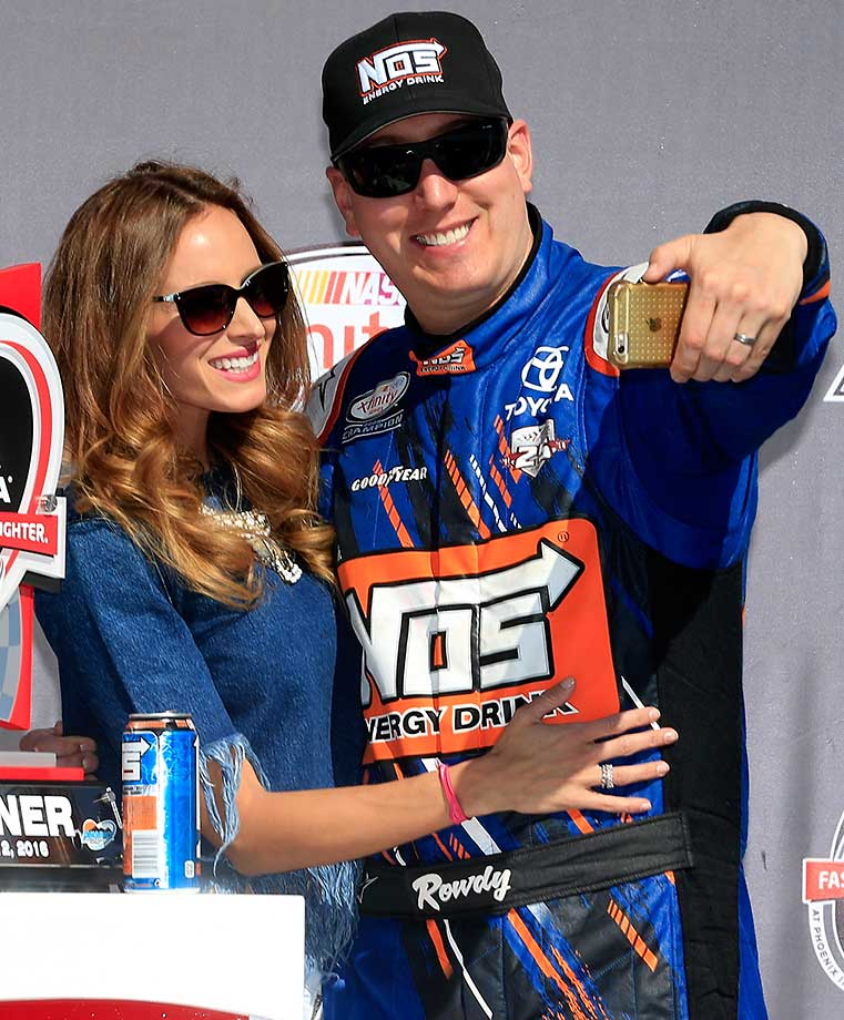 Kyle Busch celebrates in Victory Lane with his wife, Samantha, after winning the NASCAR XFINITY Series Axalta Faster. Tougher. Brighter. 200 in Arizona.