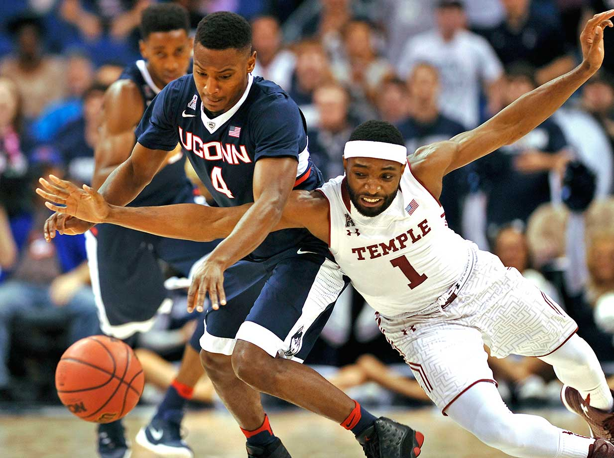 Connecticut's Sterling Gibbs steals the ball from Temple's Josh Brown.