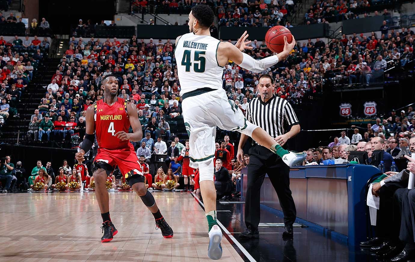 Denzel Valentine of Michigan State saves the ball from going out of bounds in front of Robert Carter of Maryland.
