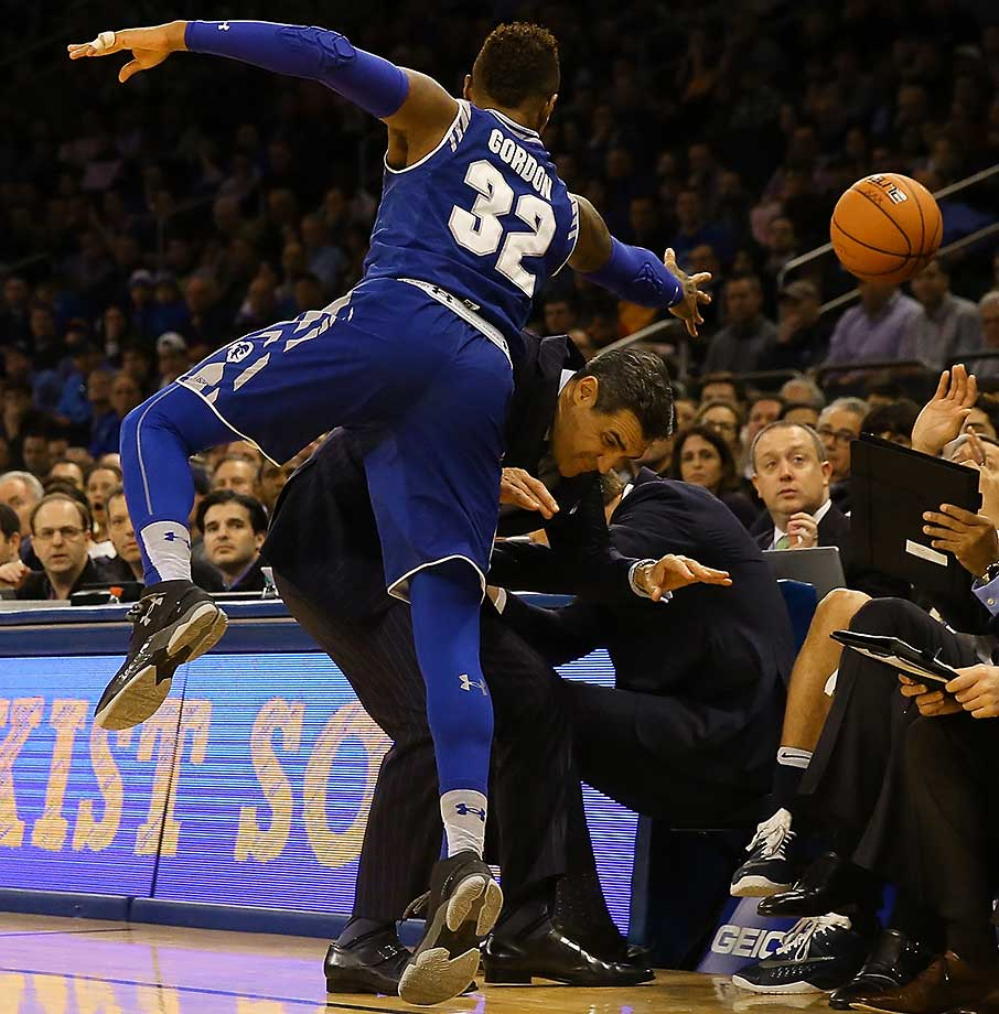 Derrick Gordon of Seton Hall collides with Villanova coach Jay Wright.