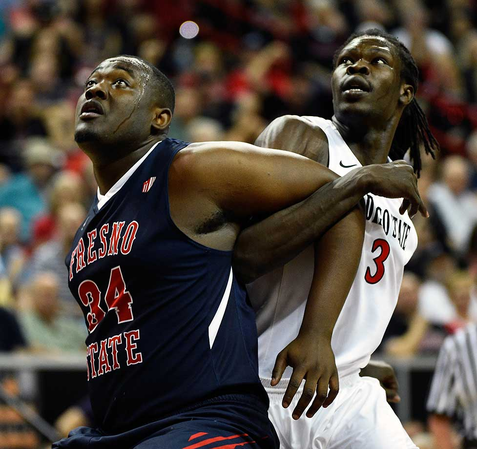 Terrell Carter II of Fresno State fights for position against Angelo Chol of the San Diego State Aztecs.