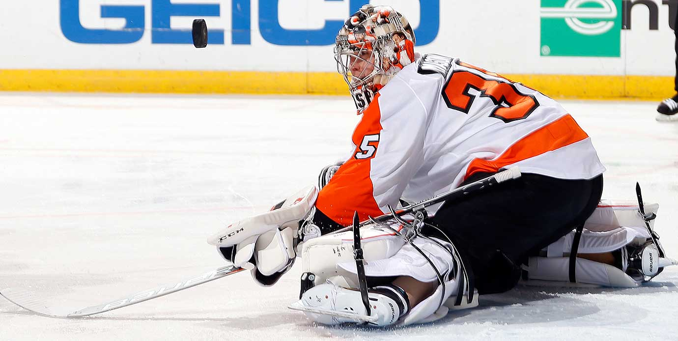 Steve Mason of the Philadelphia Flyers keeps his eye on the puck while defending the net against the Florida Panthers.