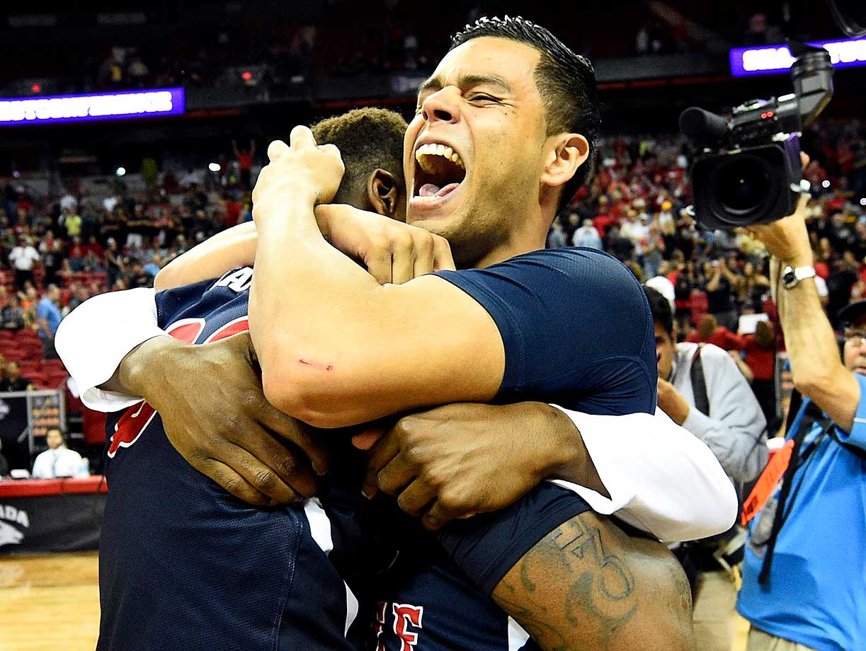 Cezar Guerrero of Fresno State celebrates with teammates after defeating San Diego State to earn an automatic bid to the NCAA Tournament.