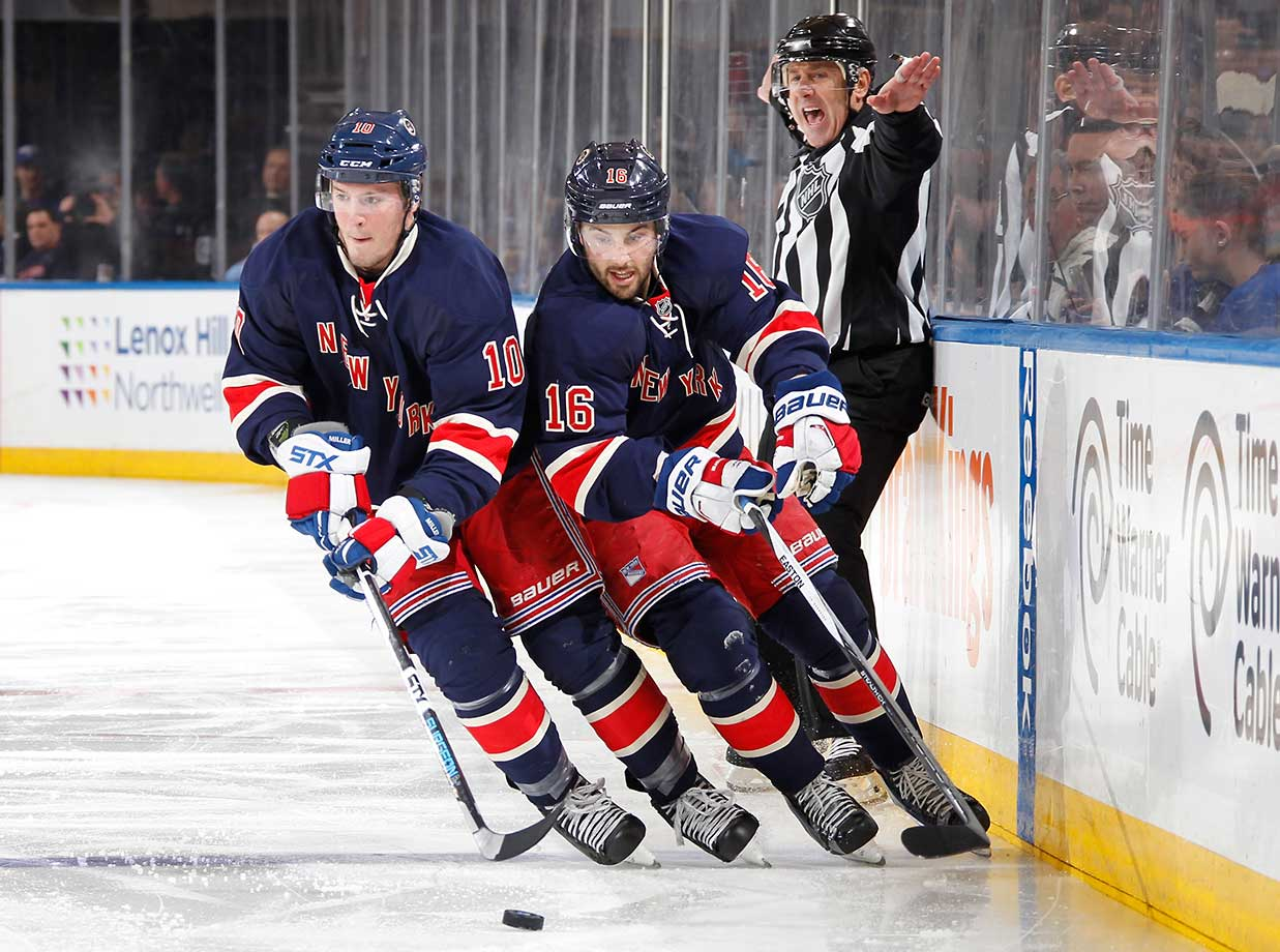 J.T. Miller (10) and Derick Brassard of the New York Rangers skate up the ice against the Pittsburgh Penguins.