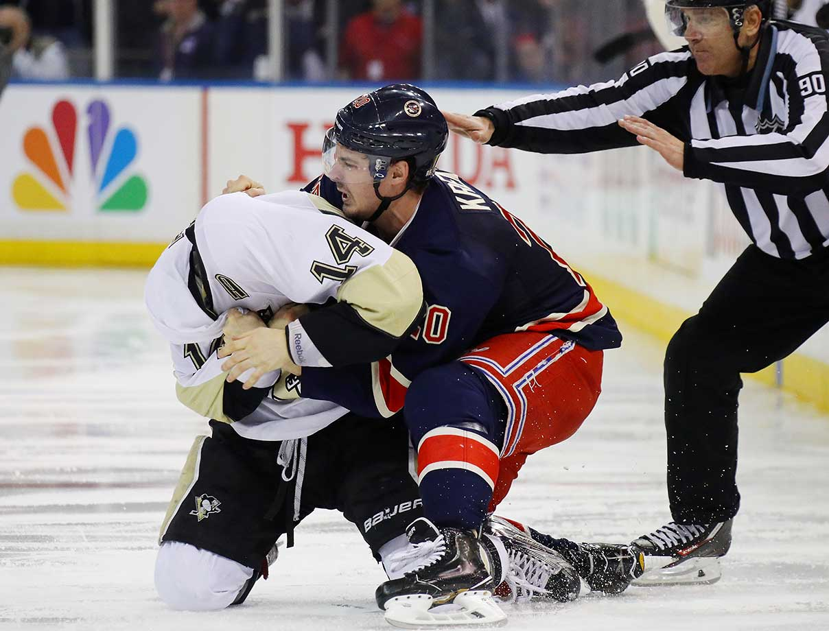 Chris Kreider of the New York Rangers gets the upper hand in his fight with Chris Kunitz of Pittsburgh.