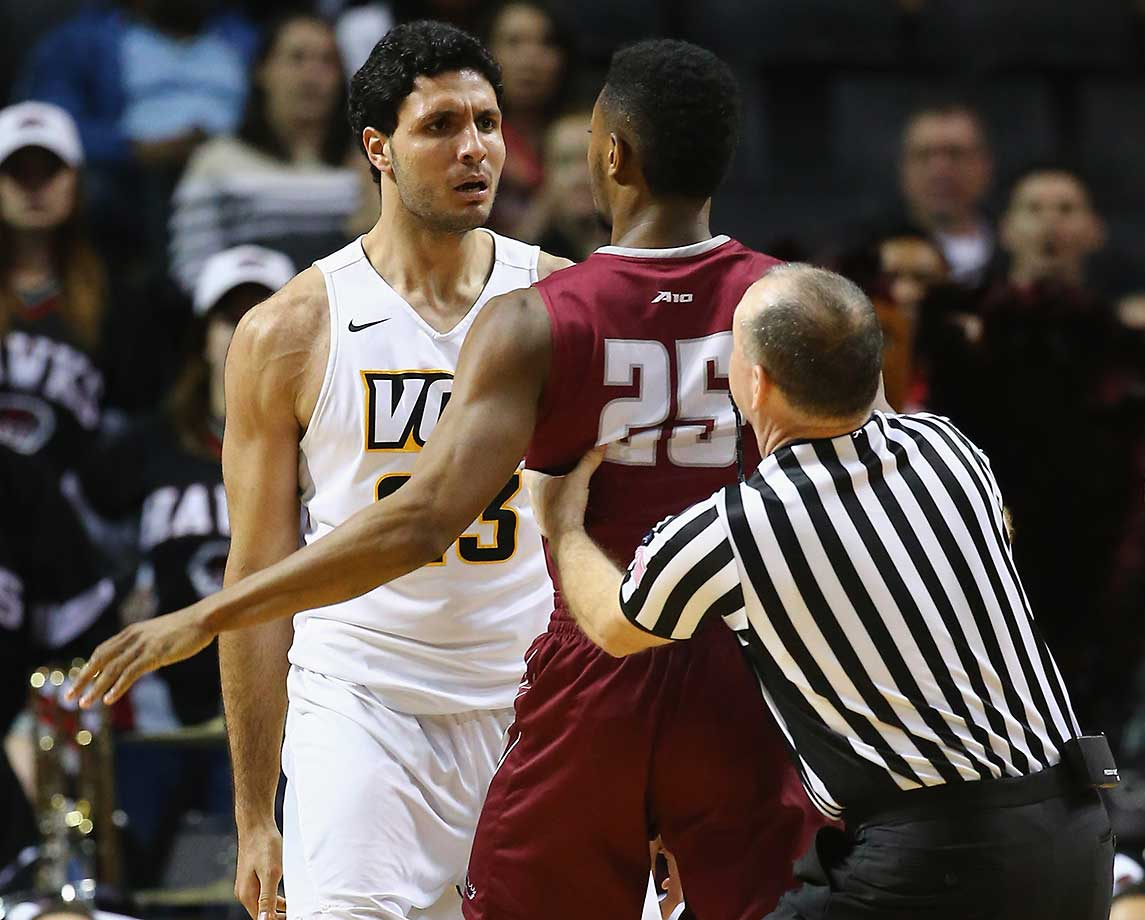 James Demery of Saint Joseph's and Ahmed Hamdy-Mohamed of VCU argue after a fight for the ball.