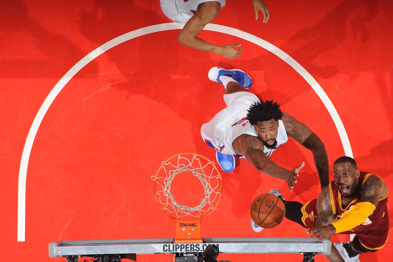 LeBron James hooks a shot against the defense of DeAndre Jordan of the Clippers.