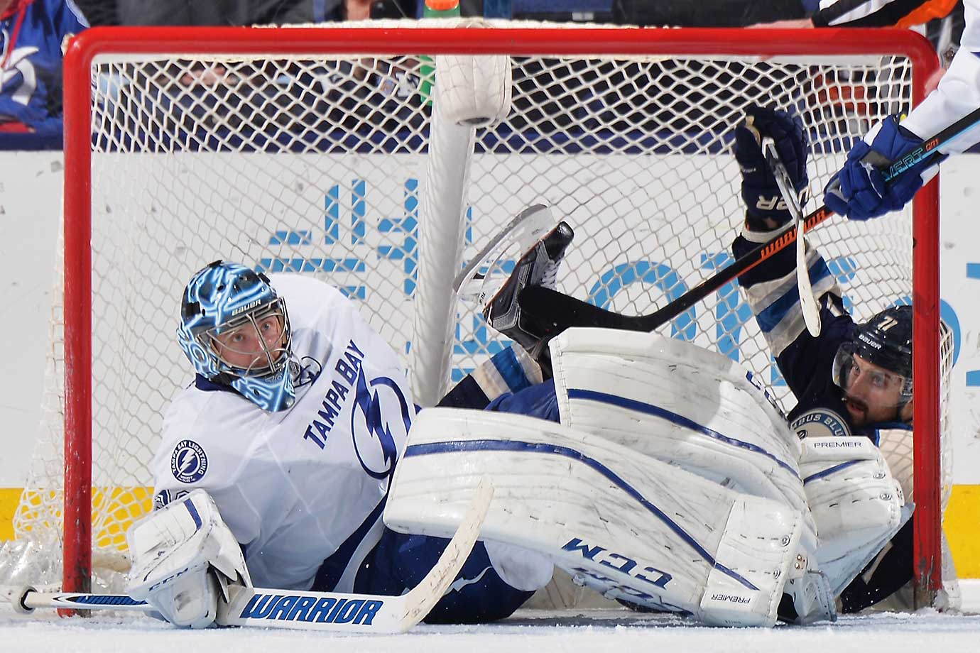 Goaltender Ben Bishop of Tampa Bay and Nick Foligno of Columbus collide into the net.