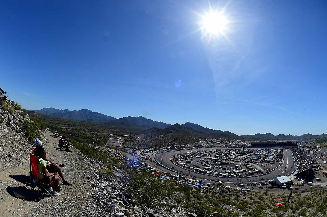 Race fans enjoy the action during the NASCAR Sprint Cup Series Good Sam 500 at Phoenix International Raceway.