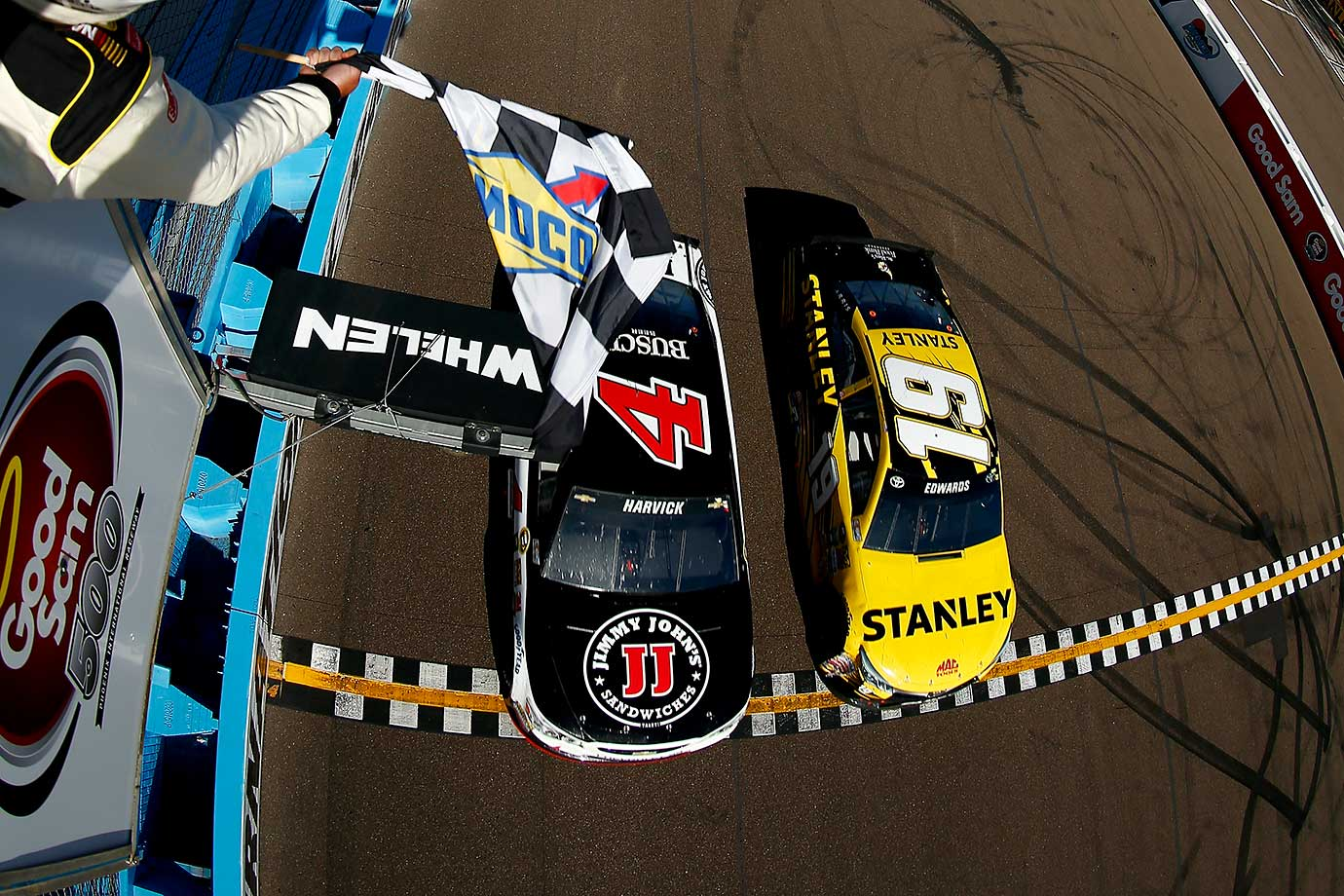 Kevin Harvick beats Carl Edwards by the narrowest of margins to win the NASCAR Sprint Cup Series Good Sam 500 at Phoenix International Raceway.