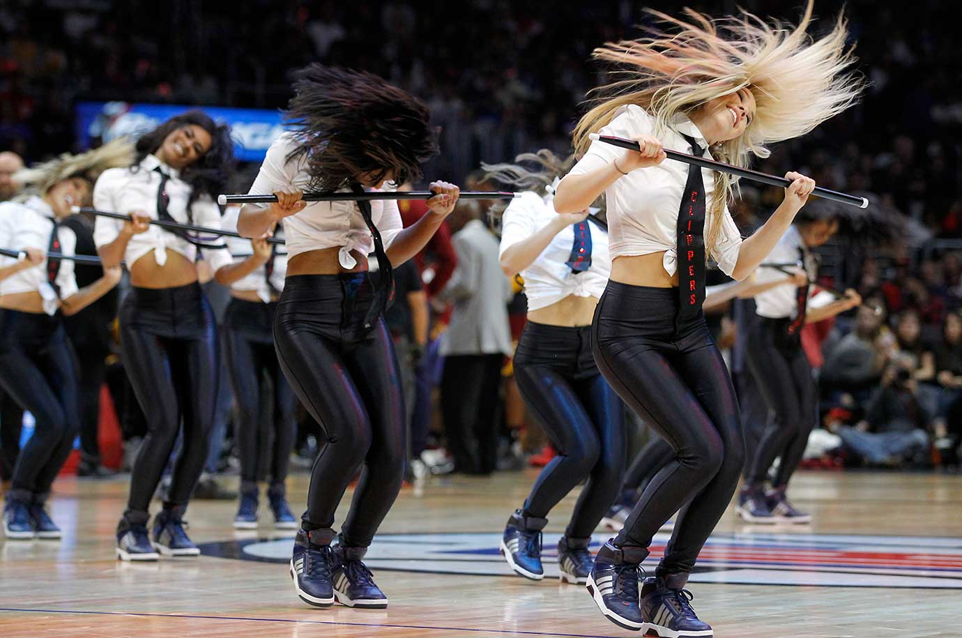 The Los Angeles Clippers Spirit cheerleaders go through a routine during a timeout.