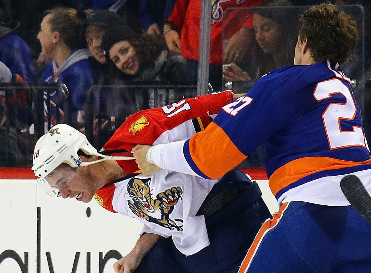 Reilly Smith of the Florida Panthers and Anders Lee of the New York Islanders fight.