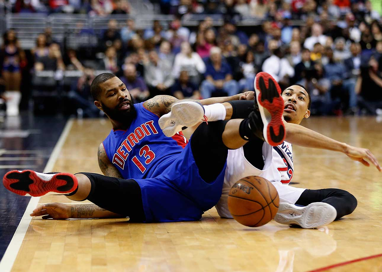 Marcus Morris of the Detroit Pistons and Otto Porter Jr. of the Washington Wizards go after a loose ball.