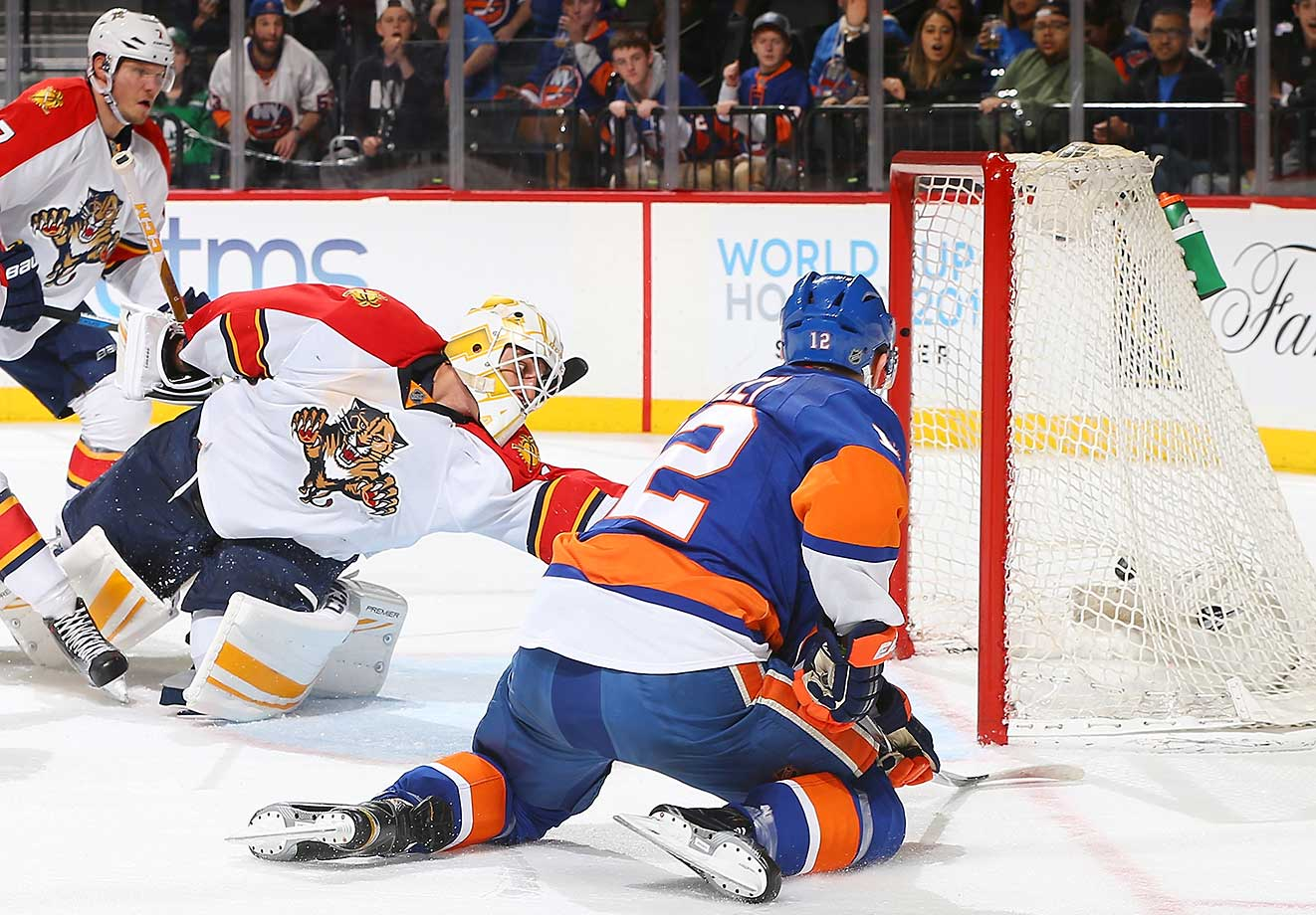 Josh Bailey of the New York Islanders scores a goal on Roberto Luongo of the Florida Panthers.