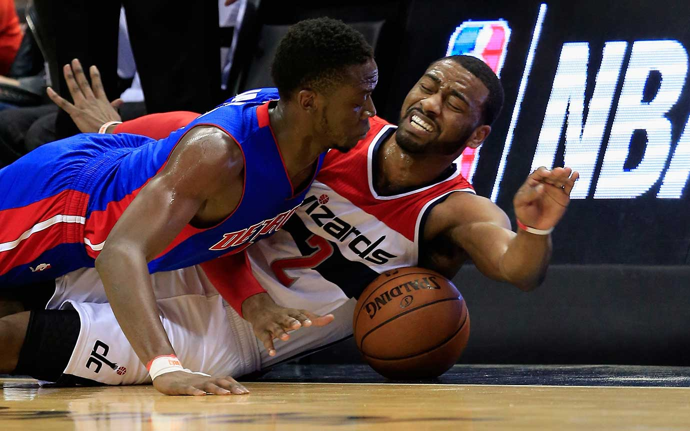 Reggie Jackson of Detroit and John Wall of Washington go after a loose ball.