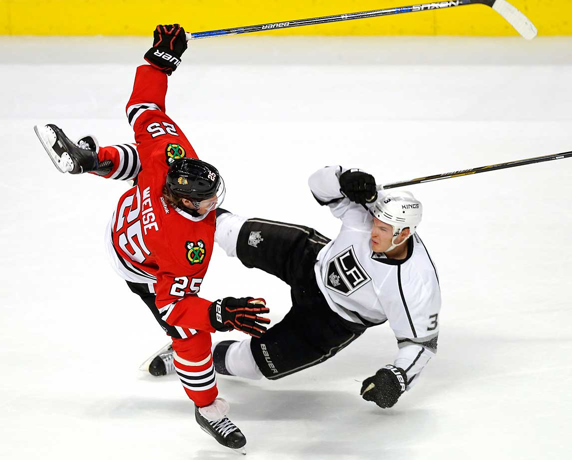 Chicago right wing Dale Weise collides with Los Angeles Kings defenseman Brayden McNabb.