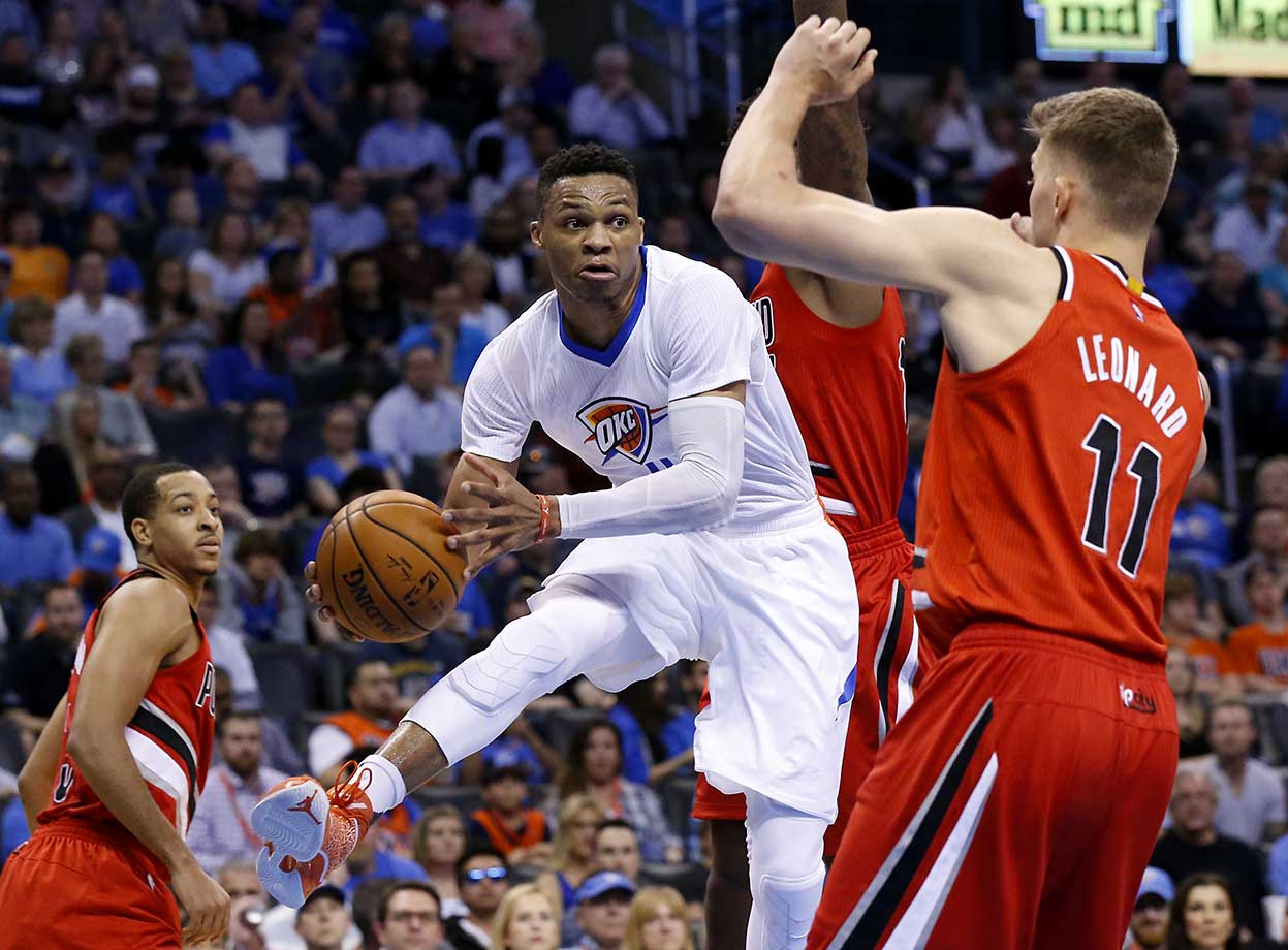 Russell Westbrook passes around Meyers Leonard as Portland visited Oklahoma City on Monday.