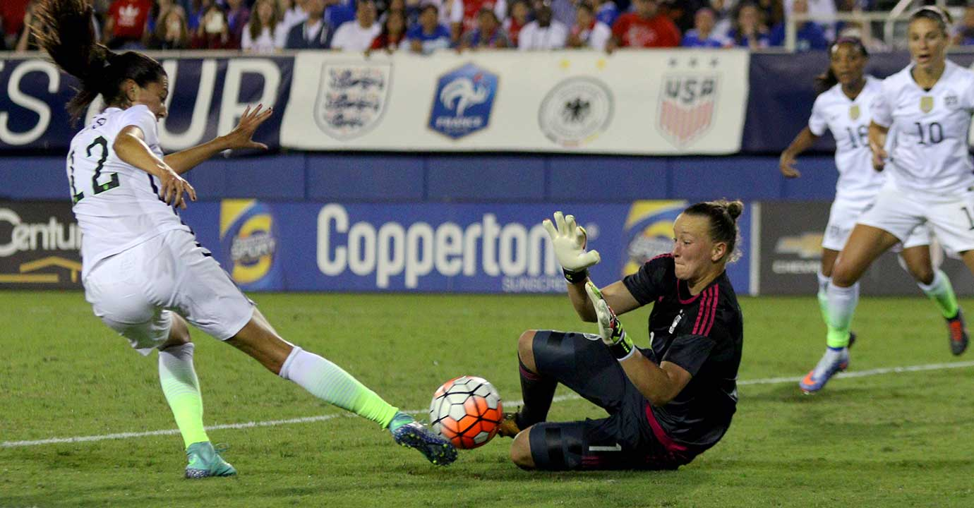 Germany's Almuth Schult blocks a shot by United States forward Christen Press in the SheBelieves Cup tournament final.